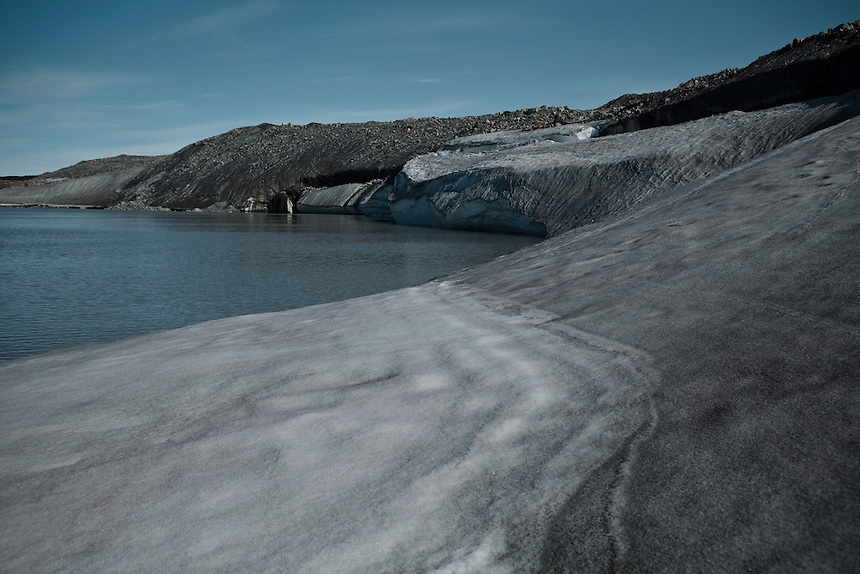 A bank of snow, lake of meltwater and glacial moraine sit at the edge of the ice cap, West Greenland, August 2011. Photo: Ed Giles.