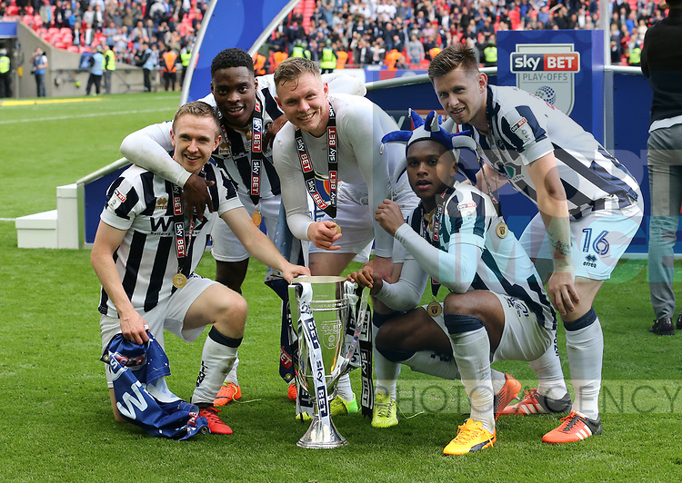 Millwall's players celebrate with the trophy during the League One Play-Off Final match at Wembley Stadium, London. Picture date: May 20th, 2017. Pic credit should read: David Klein/Sportimage