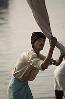 A washerman (dhobi wallah) washing clothes on the bank of River Ganga in Varanasi. (Photo by Matt Considine - Images of Asia Collection)