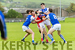 Daingean Uí Chúis Maitiú Ó Flaitheartaigh in possession of the ball tackled by Kerins O'Rahilly's Dattagh McElligott, David Moran and Tom Hoare during the County Senior Football Champhionship Round 2A match at Pairc An Aghasaigh, Dingle, on Saturday evening.