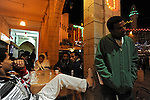 Eritrean asylum-seekers, living in Tel Aviv, Israel, hang out in a cafe at Mangar Square in Bethlehem, West Bank, as their community celebrates the Coptic Christmas in the city.