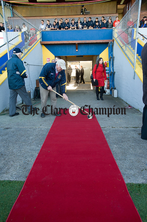 Michael Maher prepares the red carpet for the arrival of President Michael D. Higgins to Cusack Park for the Ireland V Scotland senior hurling shinty International game. Photograph by John Kelly.