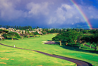 A woman walks on a path through Kapalua Bay Golf Course. This is the first of three championship golf courses in Kapalua, was designed by Arnold Palmer and Francis Duane and is a 6,600-yard par 72 course.