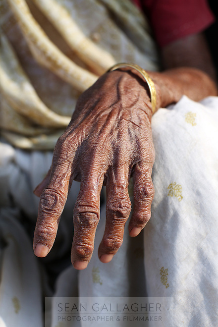 An elderly woman's hand in a small village outside Kanpur.