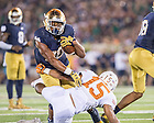 Sep 5, 2015; Irish running back C.J. Prosise (20) runs the ball against Texas. Notre Dame won 38-3. (Photo by Matt Cashore)