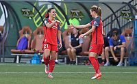 Portland, OR - Wednesday June 28, 2017: Hayley Raso and Emily Sonnett celebrate a goal during a regular season National Women's Soccer League (NWSL) match between the Portland Thorns FC and FC Kansas City at Providence Park.