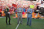 ESPN College Gameday reporters Erin Andrews, from left to right, Kirk Herbstreit and Desmond Howard on the set at Camp Randall Stadium prior to the Wisconsin Badgers NCAA college football game against the Ohio State Buckeyes on October 16, 2010 at Camp Randall Stadium in Madison, Wisconsin.(Photo by David Stluka)