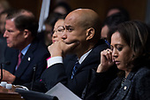 UNITED STATES - SEPTEMBER 27: Sen. Cory Booker, D-N.J., and Sen. Kamala Harris, D-Calif., listen as Dr. Christine Blasey Ford testifies during the Senate Judiciary Committee hearing on the nomination of Brett M. Kavanaugh to be an associate justice of the Supreme Court of the United States, focusing on allegations of sexual assault by Kavanaugh against Christine Blasey Ford in the early 1980s. (Photo By Tom Williams/CQ Roll Call/POOL)