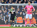 Bournemouth's Artur Boruc looks on dejected after his mistake led to Tottenham's third goal during the Premier League match at White Hart Lane Stadium.  Photo credit should read: David Klein/Sportimage