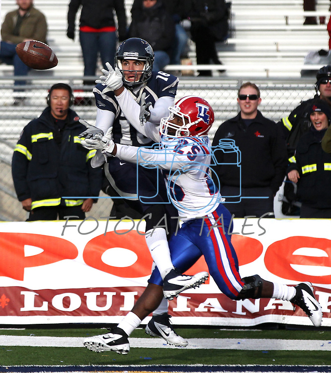 Louisiana Tech defender Justin Goodman breaks up a pass to Nevada quarterback Tyler Lantrip during the third quarter of an NCAA football game Saturday, Nov. 19, 2011, in Reno, Nev. Louisiana Tech won 24-20. (AP Photo/Cathleen Allison)