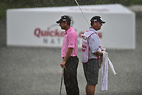 Bethesda, MD - July 2, 2017: Charles Howell III and his caddy stand back to back during a heavy rainfall that suspended play during final round of professional play at the Quicken Loans National Tournament at TPC Potomac at Avenel Farm in Bethesda, MD.  (Photo by Phillip Peters/Media Images International)