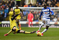 Modou Barrow of Reading is challenged by John Brayford of Burton Albion during the Sky Bet Championship match between Reading and Burton Albion at the Madejski Stadium, Reading, England on 23 December 2017. Photo by Paul Paxford.