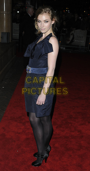 """IMOGEN POOTS .The Times BFI 53rd London Film Festival Gala screening of """"Cracks"""" at the Vue West End cinema, Leicester Square, London, England..October 25th 2009.LFF full length black dress ruffle neck waist belt tights t-bar shoes grey gray .CAP/CAN.©Can Nguyen/Capital Pictures."""