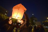 Roma, 28 Febbraio 2013.Piazza San Giovanni Bosco Per ricordare Roberto Scialabba, giovane del quartiere ucciso dai fascisti il 28 Febbraio 1978..A fine corteo vengono deposti fiori sulla targa dove uccisero Roberto e lanciate in aria lanterne rosse, 35, gli anni passati dalla  sua morte