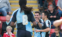 Matthew Bloomfield of Wycombe Wanderers (centre) celebrates scoring his goal during the Sky Bet League 2 match between Leyton Orient and Wycombe Wanderers at the Matchroom Stadium, London, England on 19 September 2015. Photo by Andy Rowland.