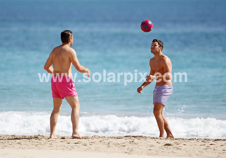 **ALL ROUND EXCLUSIVE PICTURES FROM SOLARPIX.COM.**MINIMUM PUBLICATION FEE PER PIC £150.00**.      **WORLDWIDE SYNDICATION RIGHTS**                                                                                  Mark Wright out training on the beach with his cousin Elliott Wright during his stay on the Costa del Sol. The lads took a jog before having a kick around in the surf then racing to the top of a rope climbing frame in the mid day Spanish sunshine. No wonder Mark is looking so ripped.                                                                    .This pic:   Mark Wright & his cousin Elliott.                                                                                           JOB REF:  14548    AB1       DATE:   09.03.12                                                         **MUST CREDIT SOLARPIX.COM OR DOUBLE FEE WILL BE CHARGED**                                                                      **MUST AGREE FEE BEFORE ONLINE USAGE**                               **CALL US ON: +34 952 811 768 or LOW RATE FROM UK 0844 617 7637**