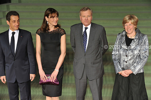 Baden-Baden, Germany - April 4, 2009 -- Heads of State and Government arrive at the NATO Summit in Baden-Baden, Germany on Saturday, April 4, 2009.  From left to right: Nicholas Sarkozy, President of France and Mrs. Carla Bruni Sarkozy with NATO Secretary General Jaap de Hoop Scheffer and Mrs de Hoop Scheffer.Mandatory Credit: NATO via CNP