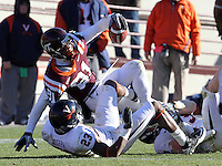Nov 27, 2010; Charlottesville, VA, USA; Virginia Tech Hokies wide receiver Jarrett Boykin (81) is tackled by Virginia Cavaliers safety Dom Joseph (23) during the game at Lane Stadium. Virginia Tech won 37-7. Mandatory Credit: Andrew Shurtleff-