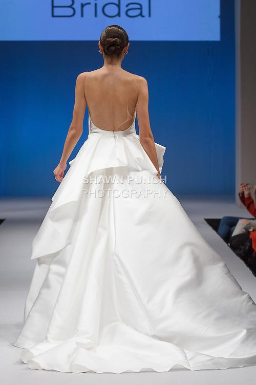Model walks runway in a Gemy Maalouf Bridal gown at the Designers Spotlight Pier 94 runway show on October 9, 2016; for New York International Bridal Week, during New York Bridal Fashion Week.