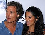 "MALIBU, CA. - September 10: Producer/Actor Matthew McConaughey and Designer Camilla Alves arrive at the ""Surfer Dude"" premiere at the Malibu Cinemas on September 10, 2008 in Malibu, California."