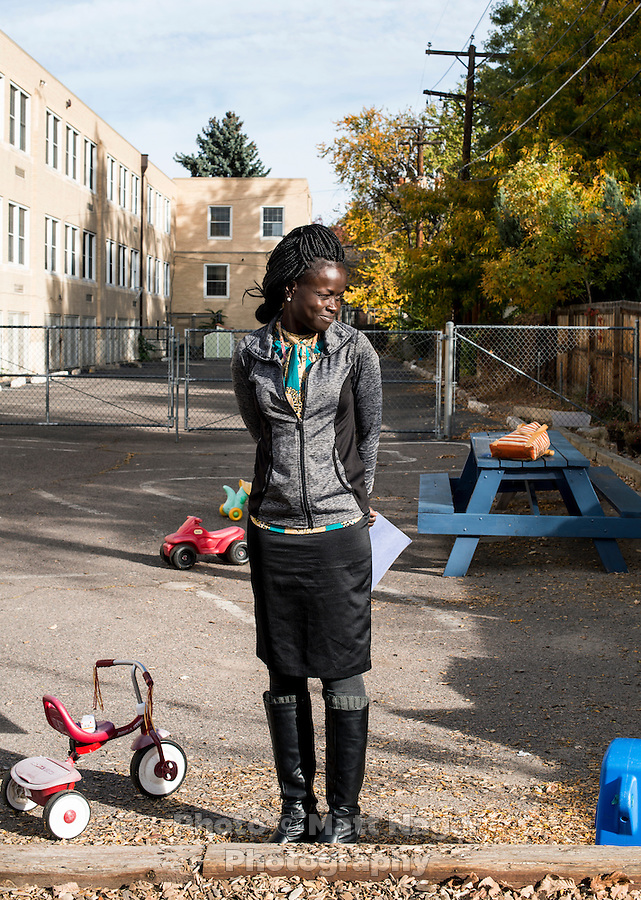 Mary Kuanen working at Blessed Sacrament Catholic School in Denver, Colorado, Friday, October 21, 2016. Kuanen a refugee from Sudan moved to Denver 11 years ago with her husband and children. Five years ago her husband was murdered in a mistaken identity gang shooting. <br /> <br /> Photo by Matt Nager