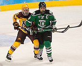 Sam Warning (MN - 11), Dillon Simpson (North Dakota - 18) - The University of Minnesota Golden Gophers defeated the University of North Dakota 2-1 on Thursday, April 10, 2014, at the Wells Fargo Center in Philadelphia to advance to the Frozen Four final.
