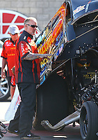 Apr 12, 2015; Las Vegas, NV, USA; Jesse James stands alongside wife NHRA funny car driver Alexis DeJoria during the Summitracing.com Nationals at The Strip at Las Vegas Motor Speedway. Mandatory Credit: Mark J. Rebilas-