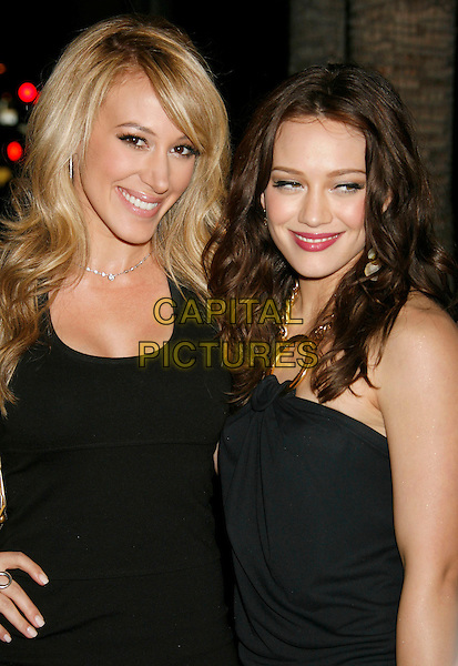 "HAYLIE DUFF & HILARY DUFF.Attending the ""Entourage"" Third Season Los Angeles Premiere held at the ArcLight Cinemas Cinerama Dome. Hollywood, California, USA, 05 April, 2007..half length black dress sisters family blonde hair brunette.CAP/ADM/RE.©Russ Elliot/AdMedia/Capital Pictures."