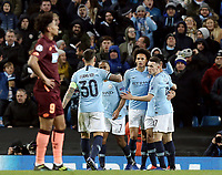 Manchester City's Leroy Sane celebrates with team-mate Phil Foden after scoring his side's second goal <br /> <br /> Photographer Rich Linley/CameraSport<br /> <br /> UEFA Champions League Group F - Manchester City v TSG 1899 Hoffenheim - Wednesday 12th December 2018 - The Etihad - Manchester<br />  <br /> World Copyright © 2018 CameraSport. All rights reserved. 43 Linden Ave. Countesthorpe. Leicester. England. LE8 5PG - Tel: +44 (0) 116 277 4147 - admin@camerasport.com - www.camerasport.com