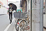 """In this photo made available on May 31, 2012 shows Mao Sugiyama walking through his neighborhood in Kanagawa, near Tokyo, Japan, on May 29, 2012. Mao Sugiyama, 22, self-described as an asexual now just 2 months old, is a cartoonist, painter and illustrator living in Japan. Mao hated the idea of love and sex due to a series of past events relating to close people around him becoming victims of sexual crimes. In an effort to free himself from mankind, Mao underwent a surgical procedure in Tokyo to remove his male genitals and later serve them to paying guests at a small dinner event. He spent two years conducting extensive research about the removal of his genitals and had several sexual experiences with others prior to the surgery. The reasoning behind Mao's idea to host an event where he would cook his male parts and serve them to guests, was he needed to earn money to help cover the ongoing medical costs of the procedure. Five individuals consisting of men and women out of a small crowd who attended the dinner, ate Mao's specially cooked genitals. The men, however, were not able to completely finish eating the genitals as they grew disgusted whereas the women were able to finish everything on their plates entirely. The women commented on Mao's parts as """"delicious."""" With Mao being an artist that he is, his vision is to create beautiful art without the realization of being a man or woman and excluding love and sex out of his system completely. (Photo by Christopher Jue/Nippon News)"""
