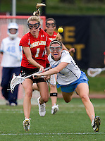 Megan Bosica (2) of North Carolina collides with Sarah Mollison (1) of Maryland during the ACC women's lacrosse tournament finals in College Park, MD.  Maryland defeated North Carolina, 10-5.
