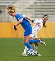 Sam Mewis (22) of UCLA fights for the ball with Nickolette Driesse (3) of Florida State during the NCAA Women's College Cup finals at WakeMed Soccer Park in Cary, NC.  UCLA defeated Florida State, 1-0, in overtime.