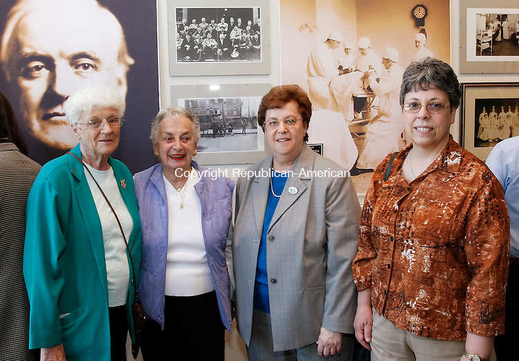 WATERBURY, CT, 05/15/09- 051509BZ15- From left- Helen D'Antonio, R.N. Saint Mary's school of nursing class of '51, who worked at the hospital for 40 years; Agnes McCarthy, R.N., taught at the nursing school and worked at the hospital for 40 years; Jeanne St. Pierre, director of the health information department and hospital employee for 32 years; Louise Carvallo, R.N., has worked at the hospital for 35 years;<br /> during the &quot;Saint Mary's Hosptial: One Hundred Years of Caring,&quot; retrospective exhibit opening reception at the Mattatuck Museum Arts and History Center in Waterbury Friday night. <br /> Jamison C. Bazinet Republican-American