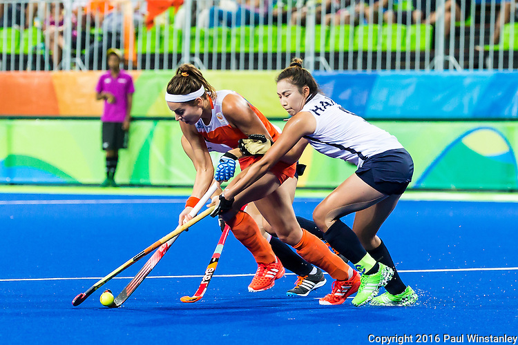 Hye Lyoung Han #9 of Korea tackles during Netherlands vs Korea in a Pool A game at the Rio 2016 Olympics at the Olympic Hockey Centre in Rio de Janeiro, Brazil.