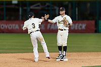 Visalia Rawhide infielders Jancarlos Cintron (3) and Camden Duzenack (1) celebrate after a California League game against the Rancho Cucamonga Quakes on April 9, 2019 in Visalia, California. Visalia defeated Rancho Cucamonga 8-5. (Zachary Lucy/Four Seam Images)