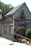 The oldest wood schoolhouse in the US appeared on the tax roles in St. Augustine in 1716, but the actual construction date is earlier and unknown.  The huge anchor was chained to the house in 1937 to prevent the house from being swept away in a hurricane.  The schoolhouse is located in the historic part of St. Augustine, Florida.