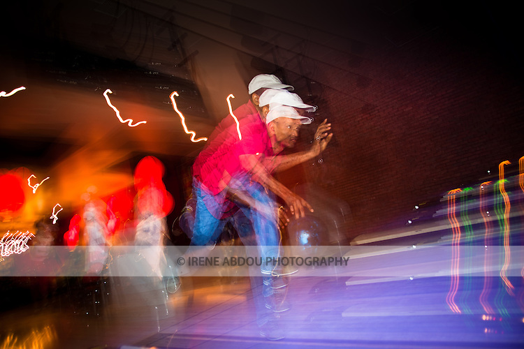 Stroboscopic flash is used to photograph a man bowling at Lucky Strike Bowling Alley in Washington DC.