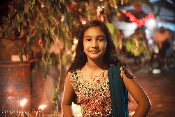 Divali,Hindu festival of light, serene face of a young Indo- Trinidadian girl