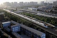 A CRH (China Railway High-speed) bullet train through  Beijing city..21 Sep 2009
