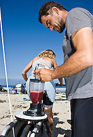 "Saturday, June 21 2009.  Pacific Beach, San Diego, CA, USA:  Dr. Marcus and his wife Eriksen and Anna Cummins of the environmental group Algalita Marine Research Foundation (AMRF) make breakfast with a bicycle-powered blender in PB one day after completing a six-week journey from Vancouver to TJ to raise awareness about marine debris.   The couple spoke at 40 different events along the way and presented 5 mayors with samples of the ""plastic soup"" that they collected form a remote part of the Pacific Ocean known as the North Pacific Gyre.  The confluence of currents in that area of the Pacific has created a high concentration of marine debris - particularly plastics - that is clogging the area, endangering marine life and entering our food chain."