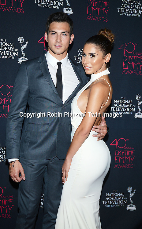 Robert Scott Wilson & date  attends the 40th Annual Daytime Creative Arts Emmy Awards on June 14, 2013 at the  Bonaventure Hotel in Los Angeles, California.