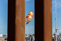 "MEXICALI, MEXICO - April 5 People demonstrated against Donald Trump with a ""baby Trump"" balloon in Calexico, California on April 5, 2019 in Mexicali, Mexico.<br /> President Trump on Friday visited Calexico, a small city in a largely agricultural region between Arizona and the Pacific, to inspect an upgraded portion of fencing and to meet with law enforcement. That's more attention than usual for a border town that locals say is defined by its interconnection with Mexico, its infernal summers and its labor-based economy. <br /> (Photo by Luis Boza/VIEWpress)"