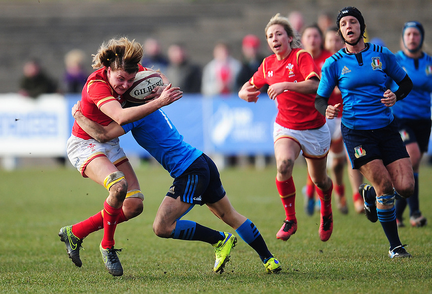 Wales&rsquo; Rachel Taylor is tackled by Italy&rsquo;s Sofia Stefan<br /> <br /> Photographer Kevin Barnes/CameraSport<br /> <br /> International Women's Rugby Union - RBS Women's Six Nations Championships 2016 Round 5 - Wales Women v Italy Women - Sunday 20th March 2016 - Aberavon RFC, Port Talbot<br /> <br /> &copy; CameraSport - 43 Linden Ave. Countesthorpe. Leicester. England. LE8 5PG - Tel: +44 (0) 116 277 4147 - admin@camerasport.com - www.camerasport.com