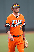 Oklahoma State Cowboys pitcher Brendan McCurry #4 before the NCAA baseball game against the Texas Longhorns on April 26, 2014 at UFCU Disch–Falk Field in Austin, Texas. The Cowboys defeated the Longhorns 2-1. (Andrew Woolley/Four Seam Images)