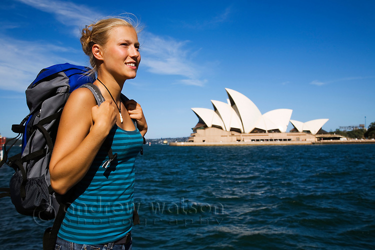 A young backpacker on Sydney harbour.  Sydney, New South Wales, AUSTRALIA