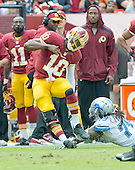 Washington Redskins quarterback Robert Griffin III (10) is tackled out-of-bounds by Detroit Lion defensive end Willie Young (79) during second quarter action against the Detroit Lions at FedEx Field in Landover, Maryland on Sunday, September 22, 2013.<br /> Credit: Ron Sachs / CNP