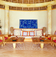 The painting of an undersea world by Sergio Hernandez dominates the palapa sitting room