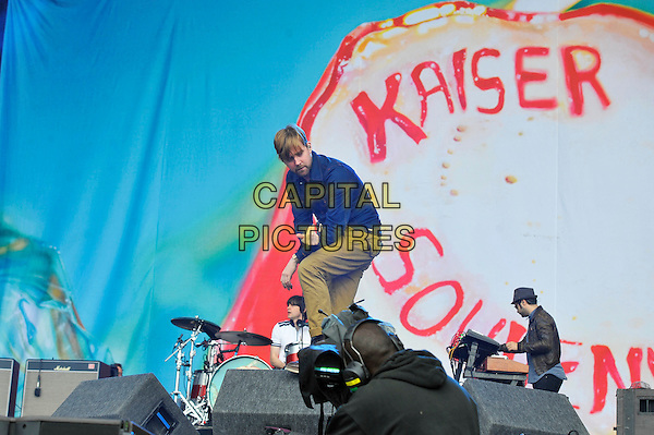 Ricky Wilson of Kaiser Chiefs.performing on Day 3 at Reading Festival, Reading, England. .26th August 2012.on stage in concert live gig performance performing music full length blue  jacket khaki trousers side beard facial hair .CAP/MAR.© Martin Harris/Capital Pictures.
