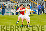 Seamus Mac Gearailt of West Kerry under pressure from Sean Rice of Castleisland District in the U14 County District Football Championship Plate final.