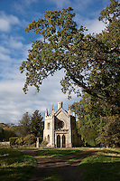 A Gothic chapel decorated with stone finials and crenellations in the grounds of Milton hall
